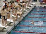220px-Swimming_relay_exchange.jpg